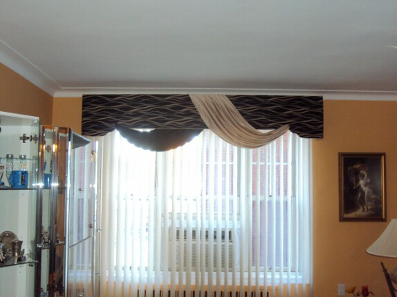 Cornice with attached swags over Fabric Verticals